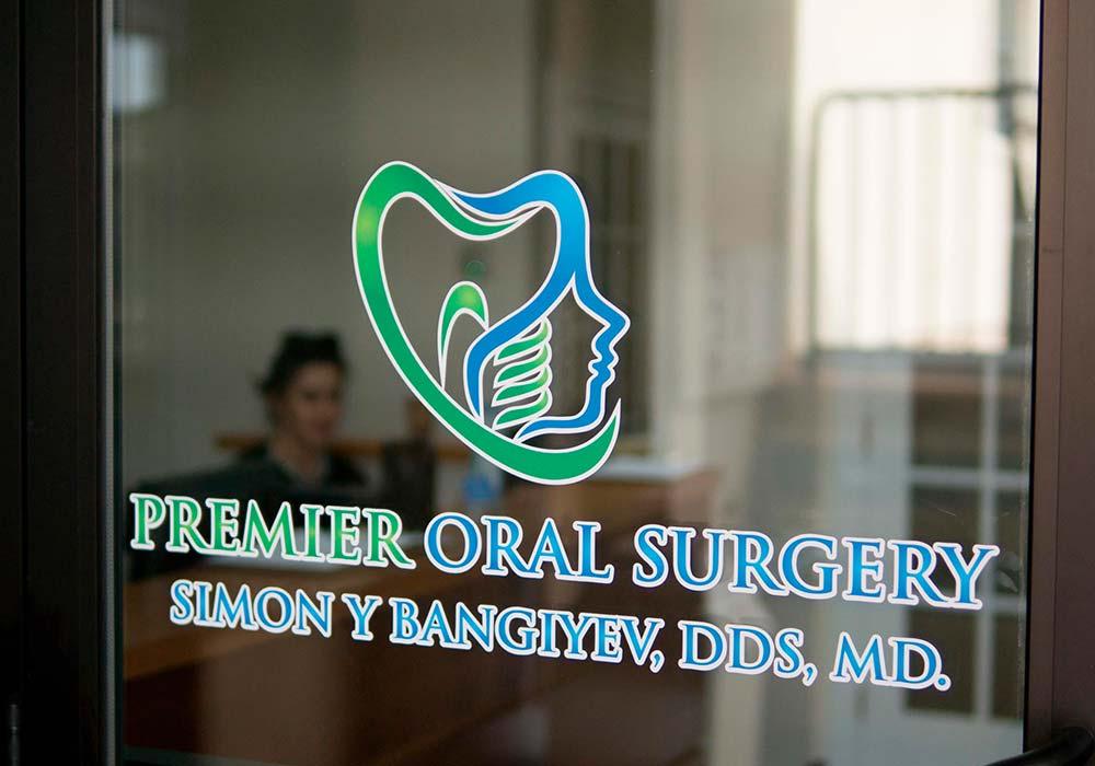 Premier Oral Surgery Door Graphic